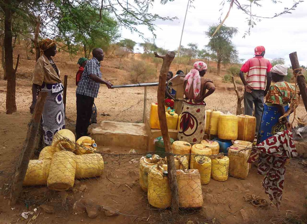 Makueni community members waiting to refill their water jugs