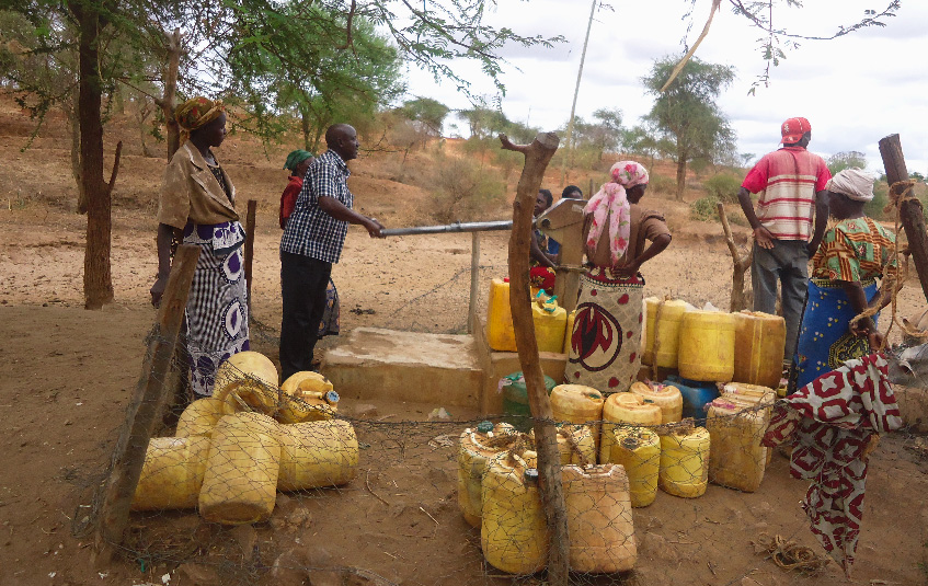 Village members gathering to fill their water jugs